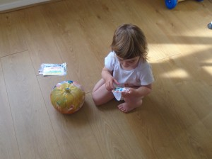 Rose peeling off stickers for her no carve pumpkin