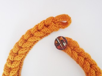 hoop and button on knitted hairband